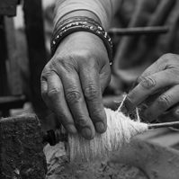 Close-up of hands making thread