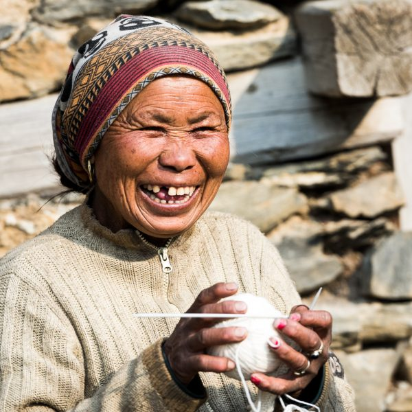 Happy woman with a ball of yarn