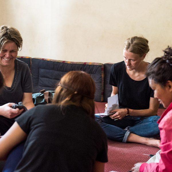 Mirjam teaching women crochet